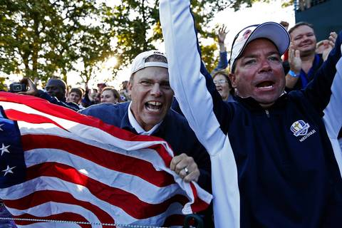 Fans cheer the USA Ryder Cup Team members Phil Mickelson and Keegan Bradley as they make their way to the seventeenth hole in the afternoon fourball play on the first day of competition at the 2012 Ryder Cup taking place at the Medinah Country Club. Mickelson and Bradley won on the seventeenth by beating the European Ryder Cup pairing of Rory McIlroy and Graeme McDowell.
