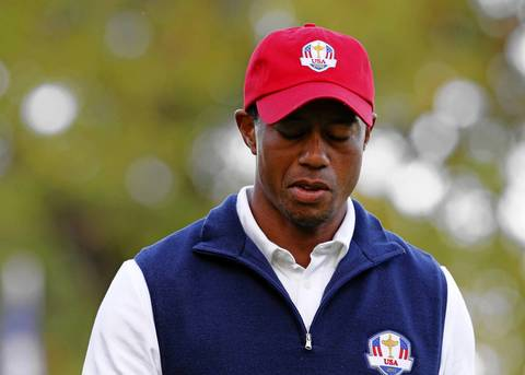 Tiger Woods reacts to missing a putt on the 18th hole during the afternoon rounds of the first day of the Ryder Cup at Medinah Country Club.