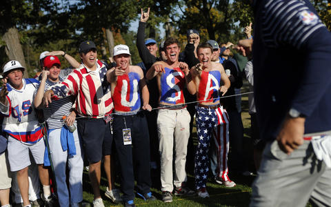 Team USA fans cheer for Phil Mickelson (right) as he finishes the 7th hole.