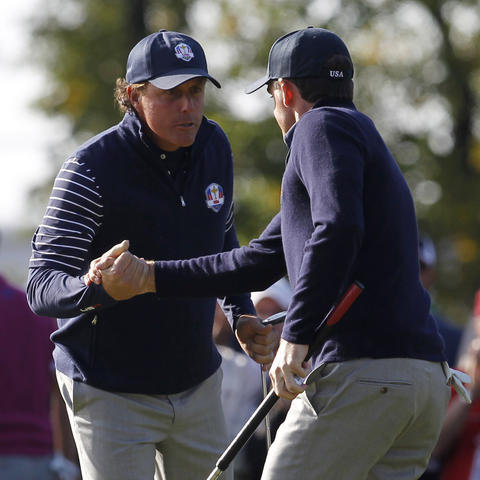 Team USA's Phil Mickelson and Keegan Bradley celebrate winning the 9th hole