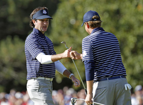 Team USA's Bubba Watson and Webb Simpson celebrate their play on the 11th hole.