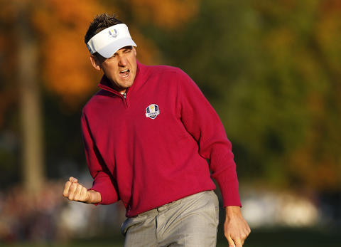 Team Europe's Ian Poulter celebrates winning the first hole of the day.