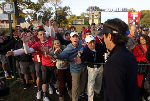 Bubba Watson high-fives fans on the 1st hole