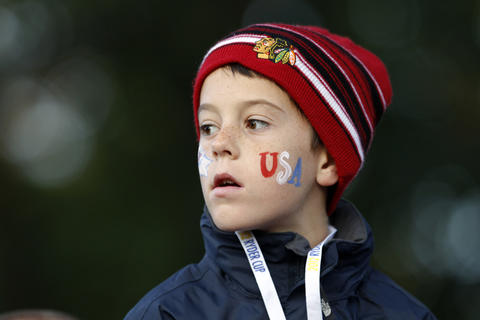 A young fan watches the morning session.