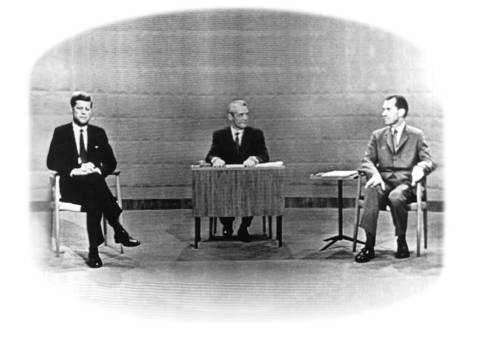 In this TV image from John Kennedy and Richard Nixon's first presidential debate in 1960, Nixon, right, appears to have a heavy 5 o'clock shadow, but photos from the event show him to be clean-shaven. Howard K. Smith was the moderator.