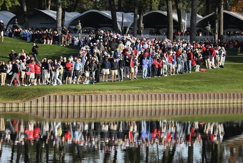 Fans take it in during the morning foursomes at Medinah Country Club.