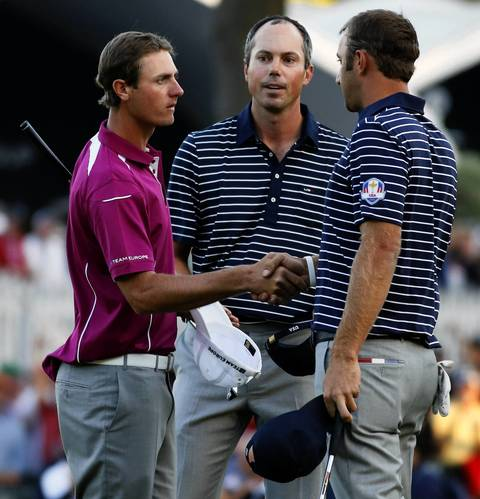 Team Europe's Nicolas Colsaerts, left, concedes to Team USA's Matt Kuchar and Dustin Johnson after the afternoon session.