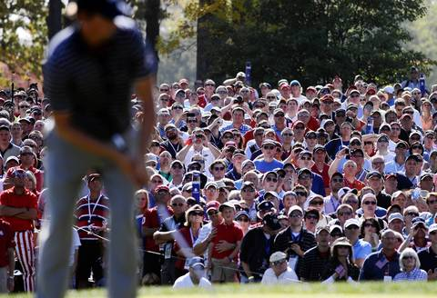 The gallery watches Team USA's Webb Simpson putt on the 7th green.