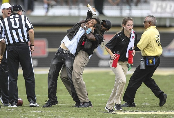 A University of Central Florida fan is removed from the field in the final seconds of second quarter action against Missouri at the Brighthouse Networks Stadium on Saturday, September 29, 2012 in Orlando, Florida. The Missouri Tigers defeated the University of Central Florida Knights, 21-16. (Joshua C. Cruey/Orlando Sentinel/MCT) ORG XMIT: 1129461 ** HOY OUT, TCN OUT **