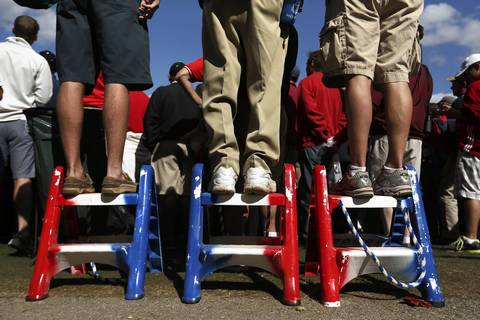 United States' fans stand on patriotic step stools at the 2nd hole.