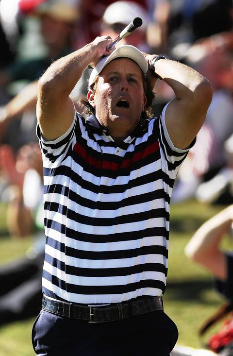 Phil Mickelson reacts to missing a chip for birdie on the 17th hole while losing his match to Europe's Justin Rose.