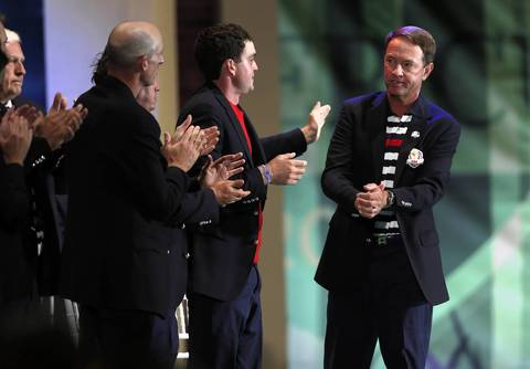U.S. captain Davis Love III is applauded by his team at the closing ceremony.