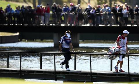 Bubba Watson crosses a bridge on the 13th hole during his loss to Europe's Luke Donald.