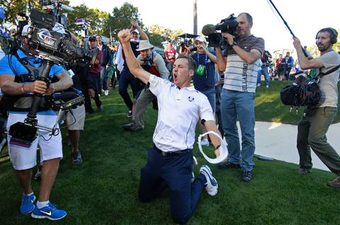 Europe's Ian Poulter hams it up for the fans.