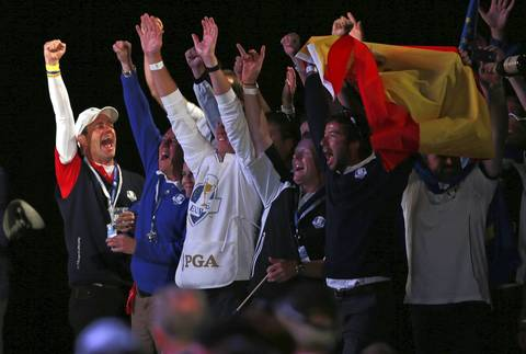 Europe's caddies celebrate during the closing ceremonies.