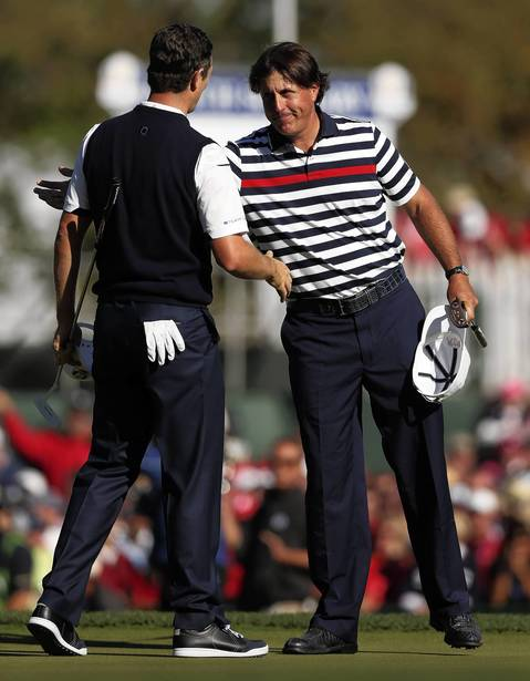 Phil Mickelson congratulates Europe's Justin Rose after Rose's win.