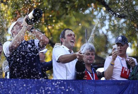 Team Europe's Francesco Molinari sprays fans with champagne following the Ryder Cup win.