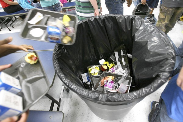 Students toss their disposable food trays at the end of lunch at Triangle Elementary in Mount Dora recently.