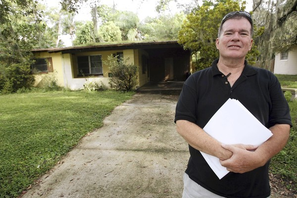 Landlord Greg May can retrieve a refrigerator he owns from his rental property, which is in foreclosure.