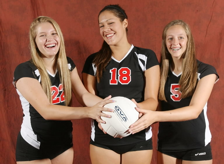Lake Mary High teammates Lauren Overby, 22, Ariana Von Lersner, 18, and Katia Haak, 5, helped Lake Mary to a win over Lake Howell in girls volleyball on Monday. (Stephen M. Dowell/Orlando Sentinel)