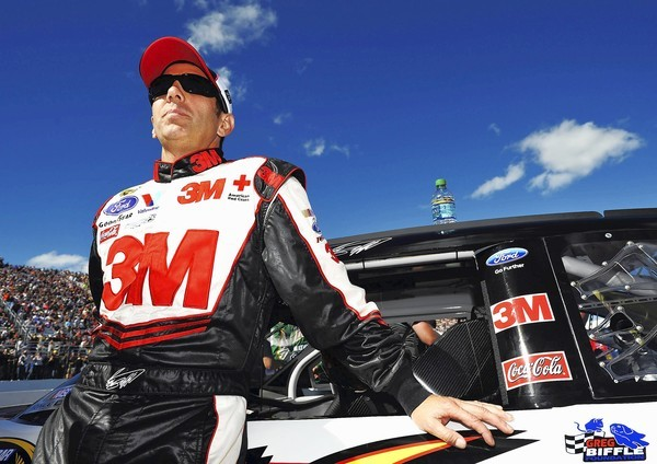 Greg Biffle stands on the grid prior to the start of the NASCAR Sprint Cup Series' Sylvania 300 race at New Hampshire Motor Speedway on September 23, 2012 in Loudon, New Hampshire.