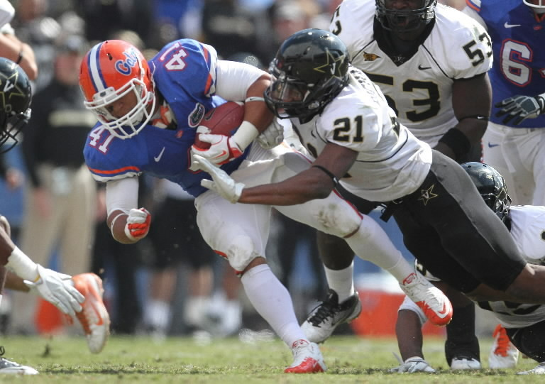 """It gets you fired up and makes you want to come play here,"" says Florida running back Hunter Joyer (41) of The Swamp."