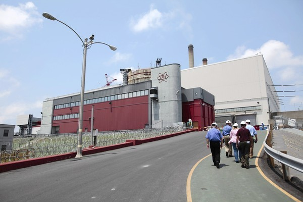 Journalists follow their escorts to CR3, the nuclear reactor facility, during a tour of the Crystal River nuclear plant.