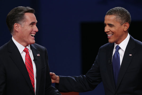 Mitt Romney and President Obama after Wednesday's presidential debate at the University of Denver.