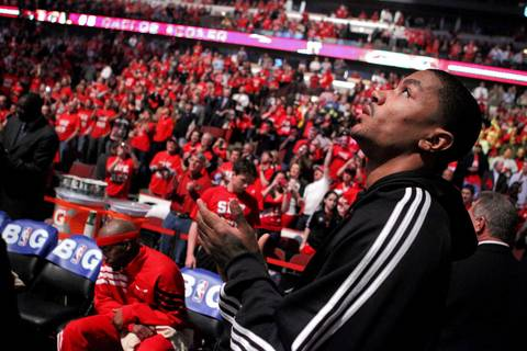Injured Chicago Bulls point guard Derrick Rose stands on the floor during player introductions before the start of the game.