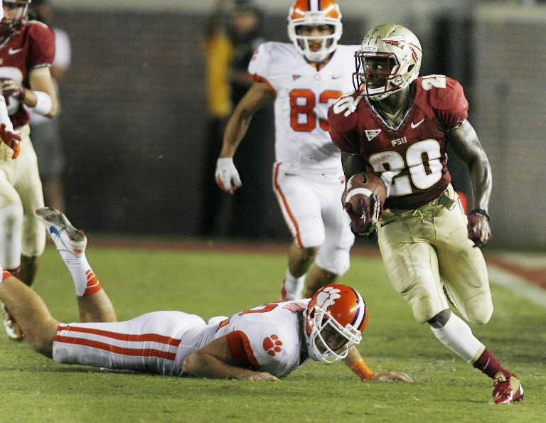 FSU returner Lamarcus Joyner (20) leaves Clemson players in his wake during a return at Doak Campbell Stadium in Tallahassee, Florida. The Seminoles won 49-37.