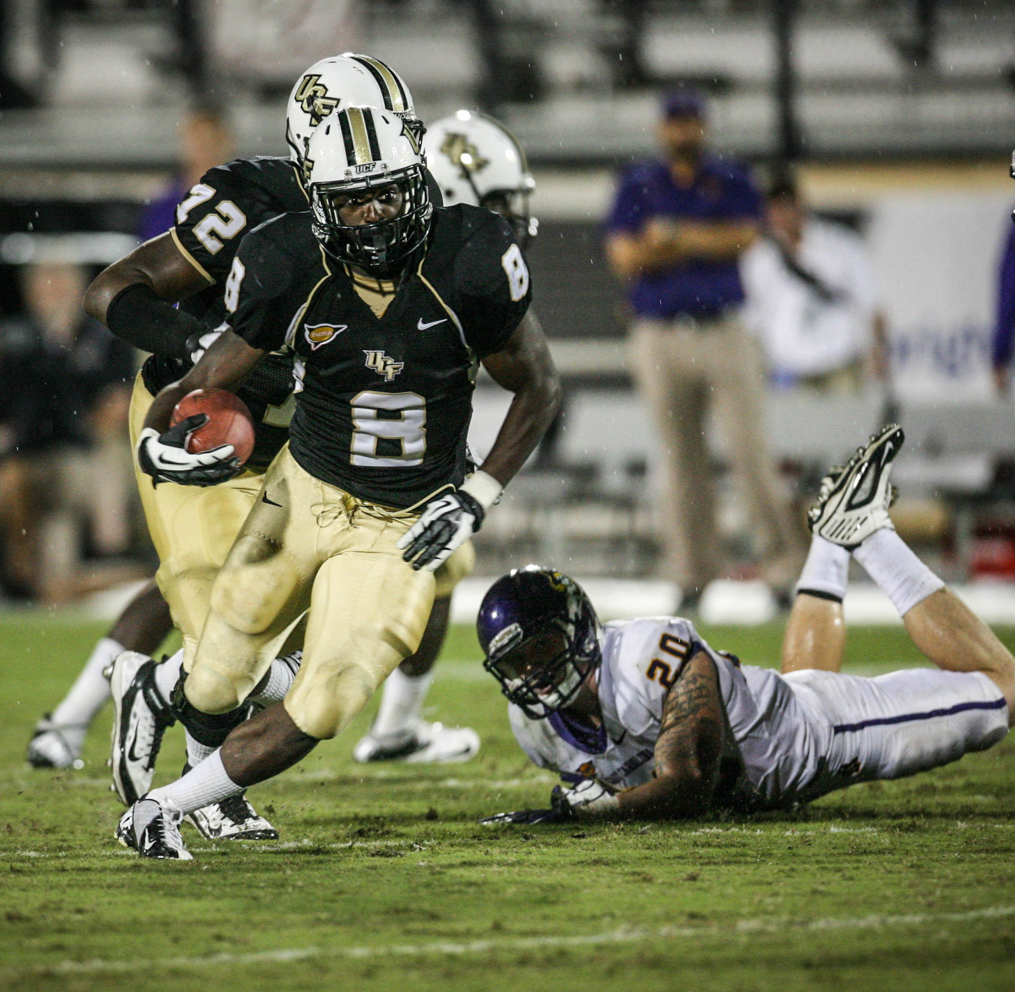 University of Central Florida running back Storm Johnson (8) slips past East Carolina's Kyle Tudor (20) during fourth quarter action of a C-USA football game against East Carolina at the Brighthouse Networks Stadium on Thursday, October 04, 2012 in Orlando, FL.