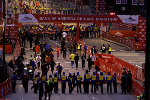 Elite runners warm up for the Bank of America Chicago Marathon on Columbus Drive early Sunday.