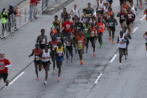 Elite marathon runners head north on Columbus Drive at the start of the 2012 Bank of America Chicago Marathon.