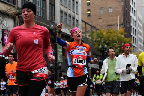 Runners head south on North State Street near the second mile of the 2012 Bank of America Chicago Marathon.