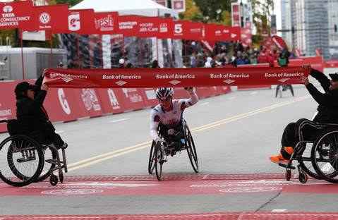 Tatyana McFadden, from the University of Illinois, wins the women's wheelchair division of the Bank of America Chicago Marathon in a time of 1:49.52. McFadden won three Gold Medals at 2012 Paralympics.