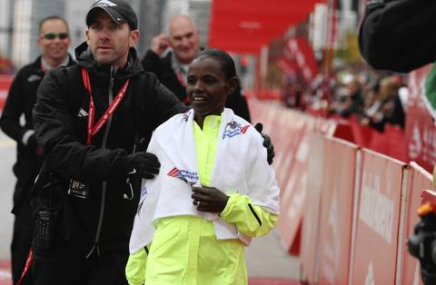 Ethiopian Atsede Baysa cools down after narrowly edging out her competitor, Kenya's Rita Jeptoo, to win the 2012 Bank of America Chicago Marathon in a time of 2 hours 22 minutes 3 seconds.
