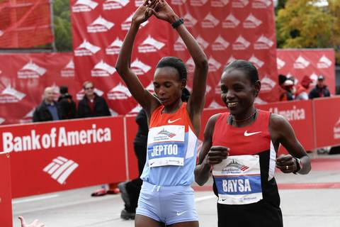 Ethiopian Atsede Baysa, right, narrowly edges out her competitor, Kenya's Rita Jeptoo, to win the 2012 Bank of America Chicago Marathon in a time of 2 hours 22 minutes 3 seconds.