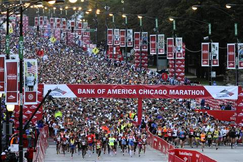 The elite marathoners leave the starting line on Columbus Drive at the start of the Bank of America Chicago Marathon