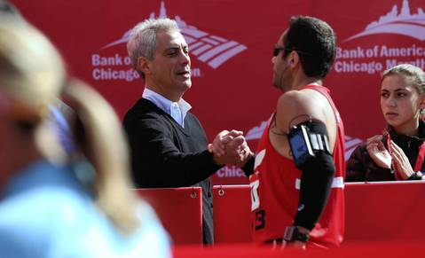 Chicago Mayor Rahm Emanuel congratulates runners at the 2012 Bank of America Chicago Marathon.