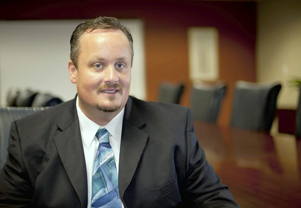 Shawn Walsh, 41, director of outreach programs for Orlando-based InCharge Debt Solutions. (October 2012)
