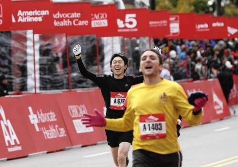 Runners celebrate crossing the finish line at the Bank of America Chicago Marathon.