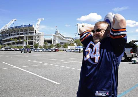 Erik Vaughn, former Purdue University Rugby coach, tosses a rugby ball while tailgating outside EverBank Field in Jacksonville, Fla., before the Jaguars take on the Bears.