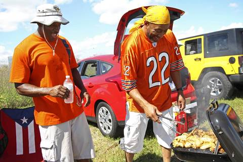 Earl Stewart, left, and Mark Jones do some grilling while tailgating at Everbank Field before the start of the game between the Chicago Bears and the Jacksonville Jaguars in Jacksonville, Florida.
