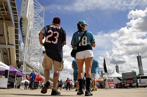 Devin Paris, and right, Kristy Viselli make their way to Everbank Field before the start of the game between the Chicago Bears and the Jacksonville Jaguars.