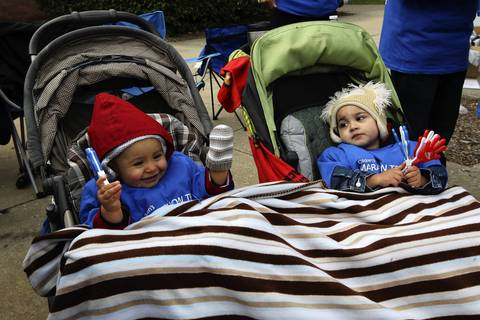 Cousins Jonathan Adams, 1, from Palatine and Joaquin Godinez, 1, from Stickney, cheer on runners at Adams and Loomis during the Chicago Marathon.