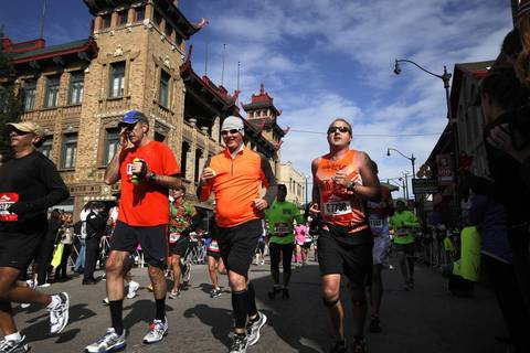 Thousands of runners from all over the world participate in the 35th Bank of America Chicago Marathon, running through many of Chicago's neighborhoods, including Chinatown.