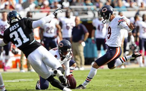 Robbie Gould kicks a field goal in the first quarter at EverBank Field.