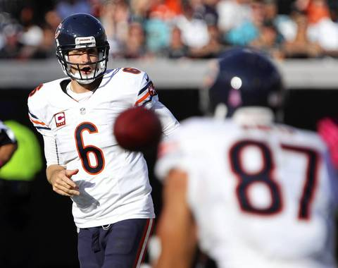 Jay Cutler completes a throw to Kellen Davis in the second quarter. The play was called back because of an offensive holding call.