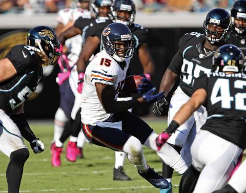 Brandon Marshall maneuvers through the Jaguars defense after a reception in the second quarter.