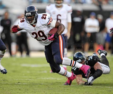 Bears running back Michael Bush clears himself of Jaguars middle linebacker Paul Posluszny during the second half.